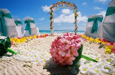 plumeria bouquet from Hawaii on the sand