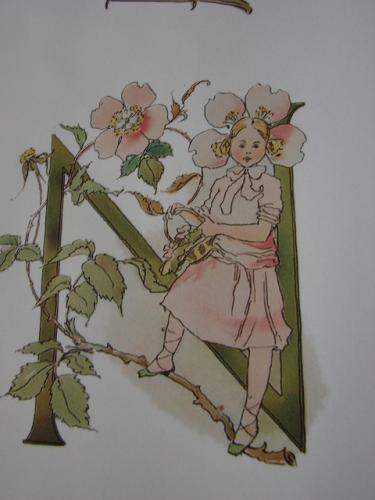 N med blommar