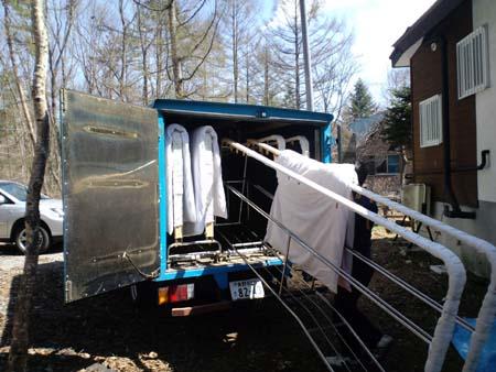 布団乾燥作業