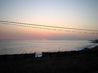 水平線に消える夕日