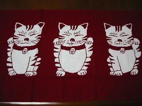 お茶目な招き猫